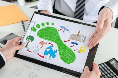 Carbon footprint concept shown by a businessman