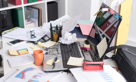 Messy And Cluttered Office Desk Stock Photo   83683765
