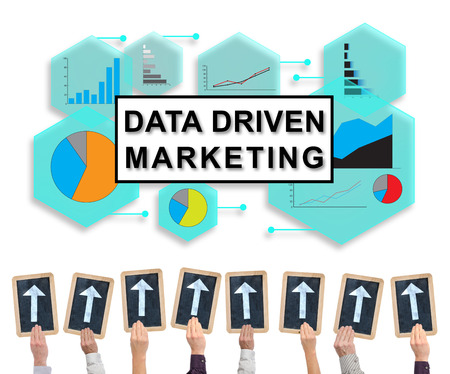 Hands holding writing slates with arrows pointing on data driven marketing concept