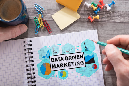 Data driven marketing concept drawn on a notepad placed on a desk