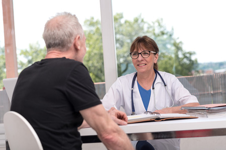 Female doctor talking with her patient in medical office