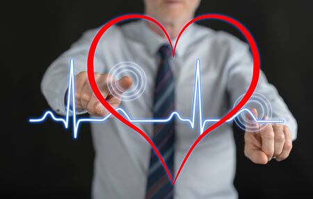 Man touching a heart beats graph on a touch screen with his fingers Banco de Imagens - 84612218