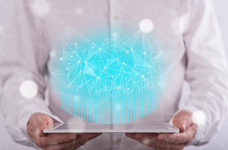 Abstract network concept above a tablet held by a man in background Stock Photo