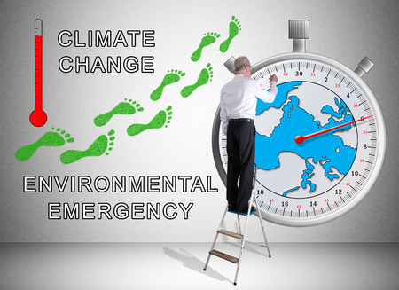 countdown: Man on a ladder drawing global warming concept on a wall