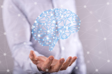 Artificial intelligence concept above the hand of a man in background