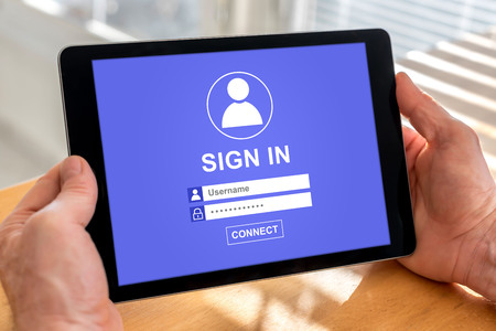 Male hands holding a tablet with sign in concept