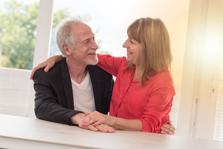 Portrait of a senior couple happy to be together, light effect