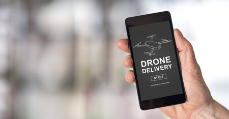 Smartphone screen displaying a drone delivery concept Stock Photo