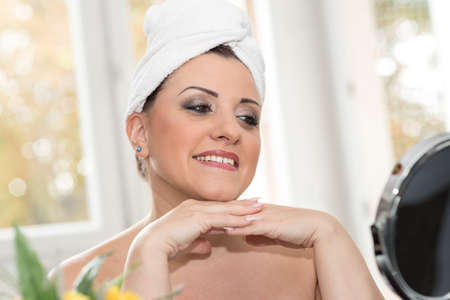 woman bath: Portrait of pretty young woman in bathroom with towel on her hair