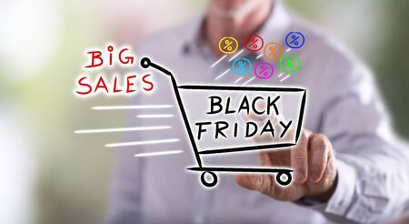 big screen: Man touching a black friday concept on a touch screen with his finger