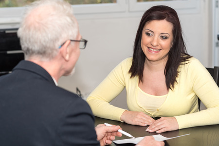 Smiling young woman meeting a financial adviser