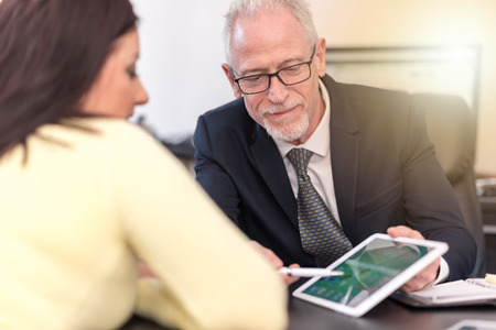 Consultant advising young woman at office, light effect Banque d'images