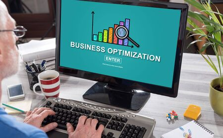 Man using a computer with business optimization concept on the screen