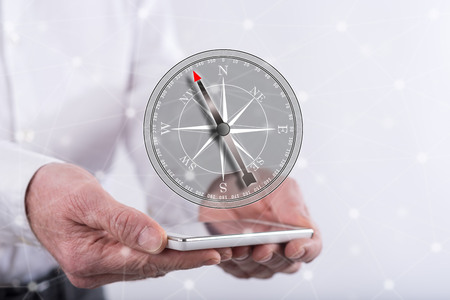 Right direction concept above a smartphone held by hands