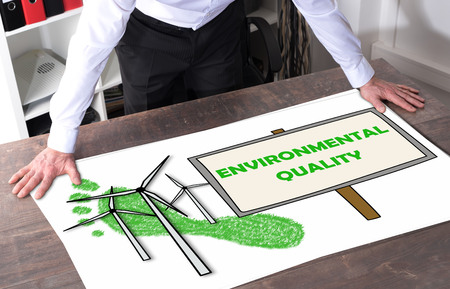 Man watching an environmental quality concept placed on a desk Stock Photo