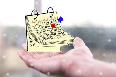 Calendar concept above a hand of a man Stock Photo