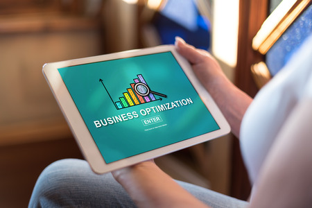 Woman holding a tablet showing business optimization concept Stock Photo