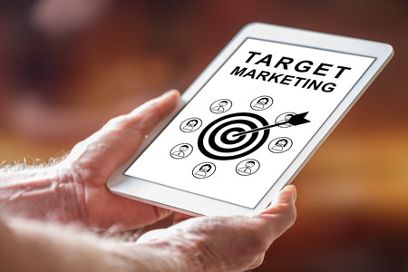 Man holding a tablet showing target marketing concept