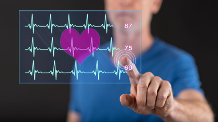 Man touching a heart beats graph concept on a touch screen with his finger Banco de Imagens - 103540539