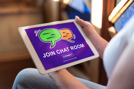 Woman holding a tablet showing chat room concept