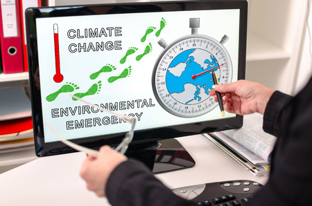 Businesswoman showing global warming concept on a computer screen Stock Photo