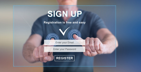 Man touching a signup concept on a touch screen with his fingers