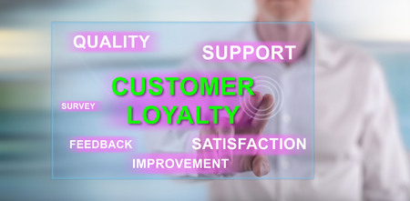 Man touching a customer loyalty concept on a touch screen with his finger Stock Photo
