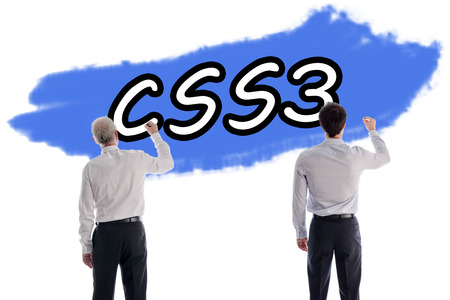 Two men writing the word css3 on a wall