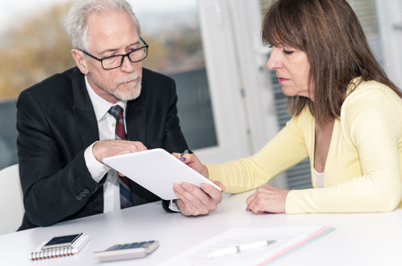 Financial consultant giving advices to female client