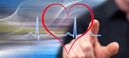 Man touching a heart beats graph on a touch screen with his finger Banco de Imagens - 108663081