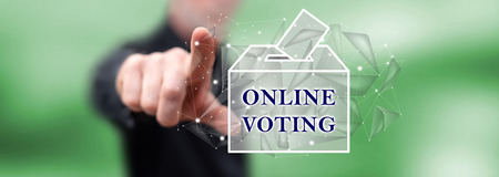 Man touching an online voting concept on a touch screen with his finger Stock Photo
