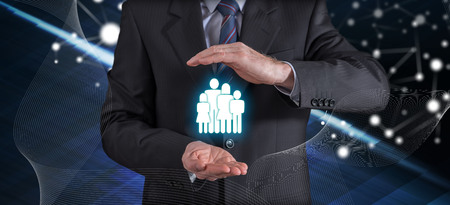 Family insurance concept with businessman in a protective gesture