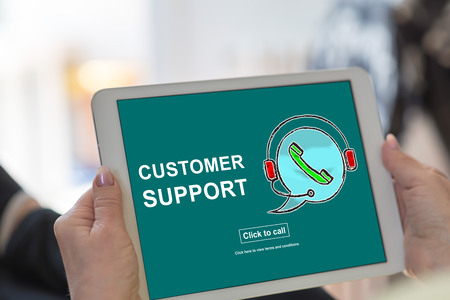 Tablet screen displaying a customer support concept 스톡 콘텐츠