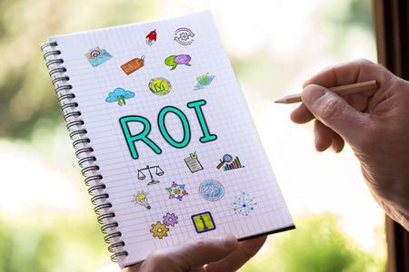Hand drawing roi concept on a notepad