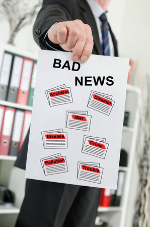 Paper showing bad news concept held by a businessman Archivio Fotografico - 111182490