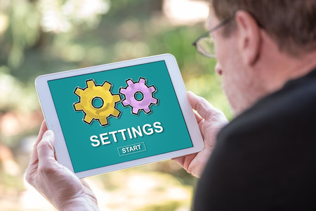 Tablet screen displaying a settings concept 写真素材