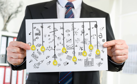 Paper showing creativity concept held by a businessman