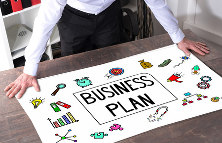 Man watching a business plan concept placed on a desk