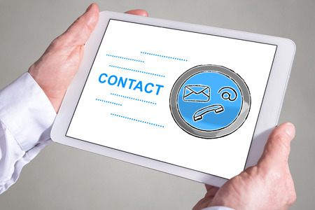 Tablet screen displaying a contact concept Banco de Imagens