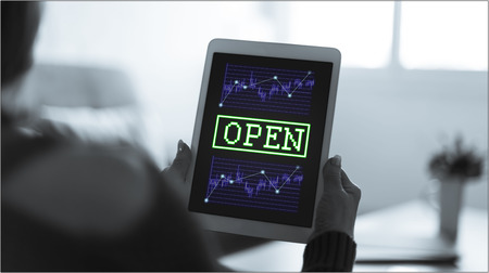 Tablet screen displaying an open stock market concept