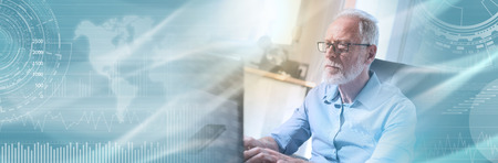 Portrait of senior businessman working on laptop in office, light effect. panoramic banner