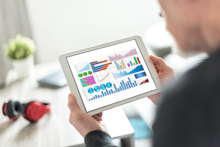Tablet screen displaying a financial analysis concept Stock Photo