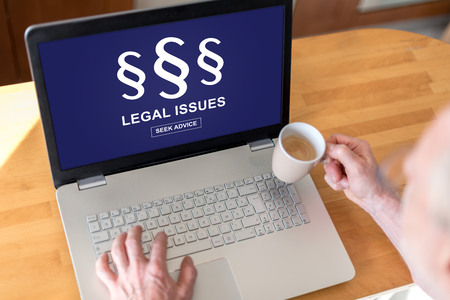Man using a laptop with legal issues concept on the screen Stock Photo