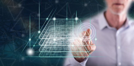 Man touching a blockchain technology concept on a touch screen with his finger