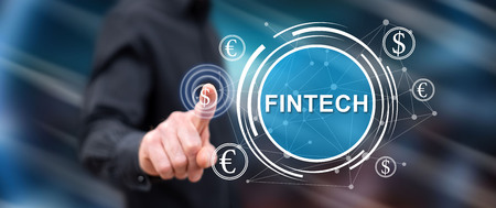 Man touching a fintech concept on a touch screen with his finger