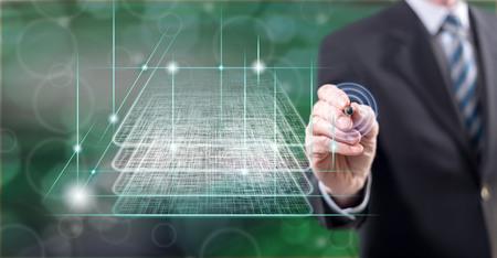 Man touching a blockchain technology concept on a touch screen with a stylus pen Reklamní fotografie