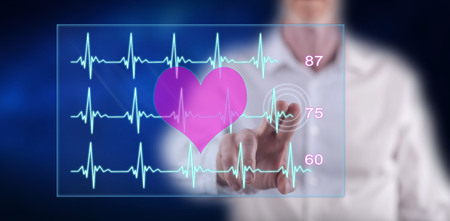Man touching a heart beats graph concept on a touch screen with his finger Banco de Imagens - 116007391