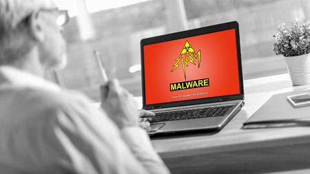 Laptop screen displaying a malware concept Imagens