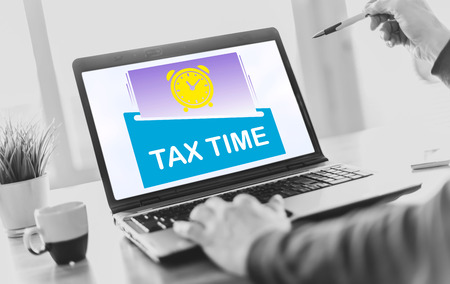 Laptop screen displaying a tax time concept Imagens