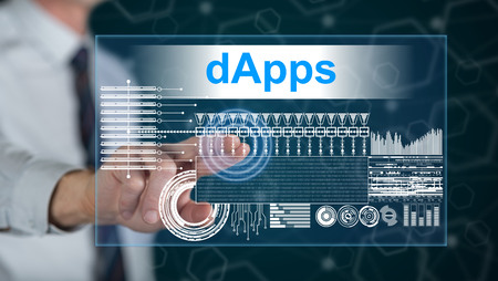 Man touching a dapps concept on a touch screen with his finger